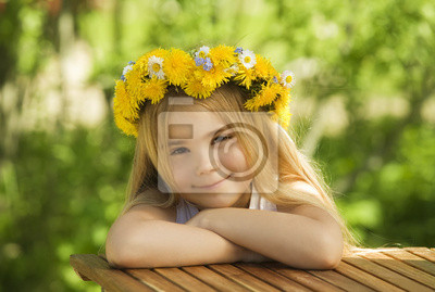 Canvas print Portrait of a little girl in wreath of flowers