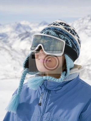 Canvas print Portrait of young woman against a background of the mountains