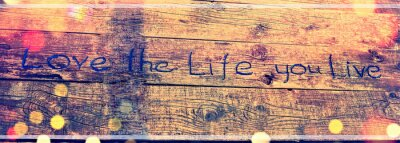 Canvas print Positive inspiring quote written carved  in wood Love the life you live. Best motivational quotes, inspirational quotes and sayings about life. Motivation, and inspiration image quote