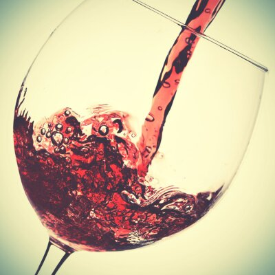 Canvas print Pouring of red wine
