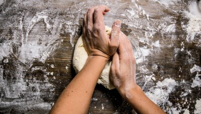 Canvas print Preparation of the dough. Preparation of the dough the women's hands.