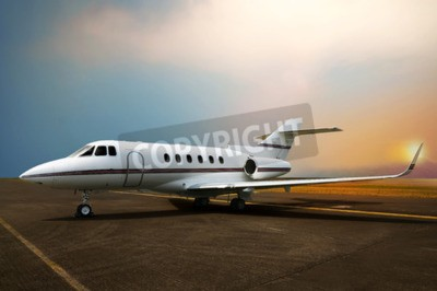 Canvas print Private jet airplane parking at the airport. With sunset background