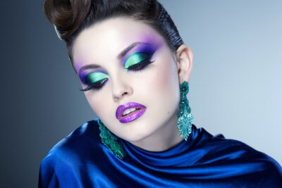 Canvas print professional blue make-up and hairstyle on beautiful woman face