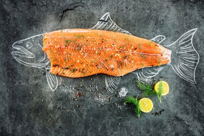 Canvas print raw salmon fish steak with ingredients like lemon, pepper, sea salt and dill on black board, sketched image with chalk of salmon fish with steak