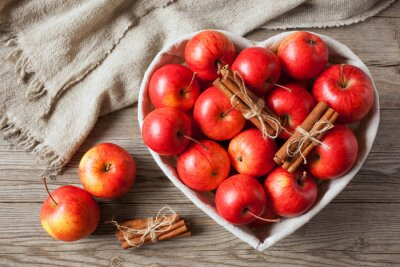 Canvas print Red apples with cinnamon