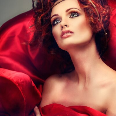 Canvas print Red hairs. Portrait of beautiful girl in red fabric