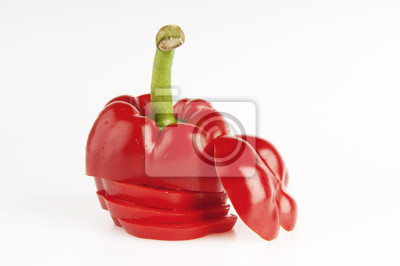 Red, sliced paprika with drops of water on white background