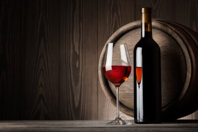 Canvas print Red wine in glass with bottle