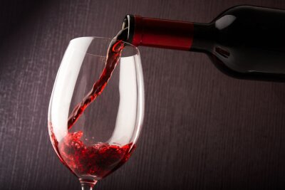Canvas print Red wine pouring