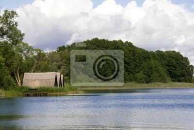 Reetdachhäuser am See