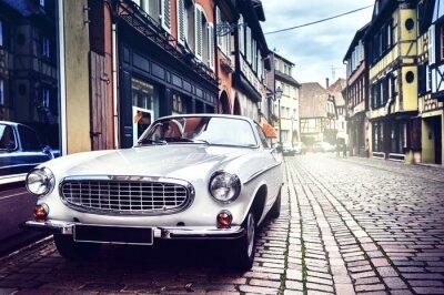 Canvas print Retro car in old city street