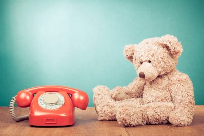 Canvas print Retro red telephone and Teddy Bear near mint green wall