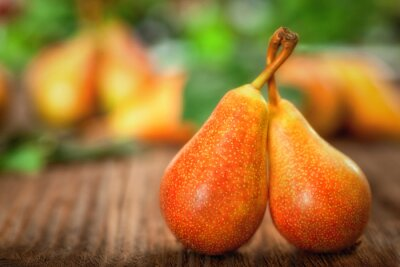 Canvas print Ripe pear on a wooden background