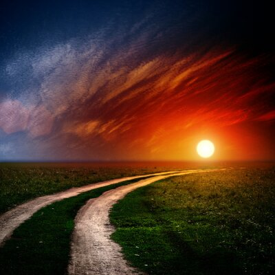 Canvas print Road in field with clouds and sun set