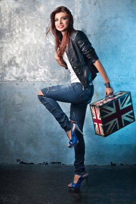 Canvas print Rock young woman with suitcase with British flag