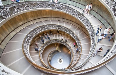 ROME, ITALY-OCTOBER 17: Unidentified people down the spiral staircase of Vatican Museums in Rome October 17, Italy.  These stairs were designed by Giuseppe Momo in 1932