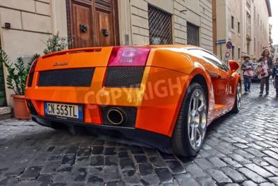 Canvas print Rome, October 23, 2010: A Lamborgini is parked on a cobblestone street.