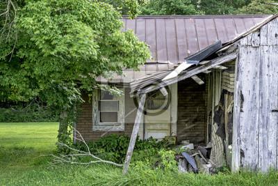 Rundown shack with tree blowing in wind
