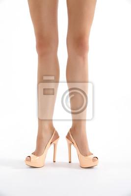 Schöne Beine mit High Heels in komischer Pose