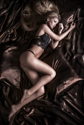 Canvas print Sensual blonde woman posing in lingerie.
