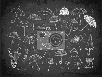 Set of doodle sketch umbrellas on blackboard background