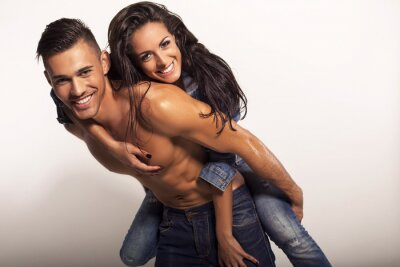Canvas print sexy beautiful couple in jeans