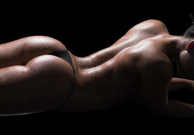 Canvas print Sexy woman body, wet skin, black background