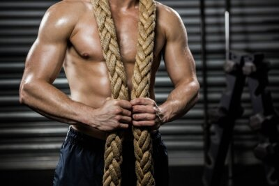 Canvas print Shirtless man with battle rope around neck