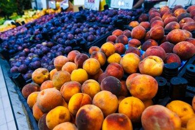 Shop bazaar fruits and vegetables. Set of plum fruits, peaches, grapes