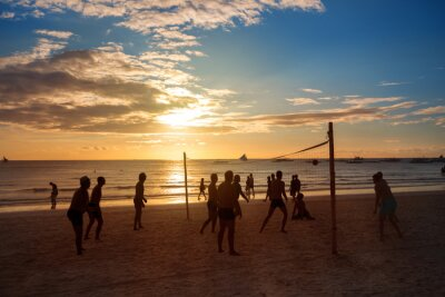 Canvas print Silhouette people playing volleyball