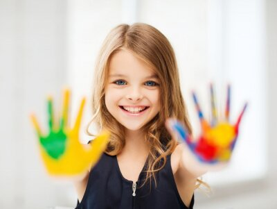 Canvas print smiling girl showing painted hands