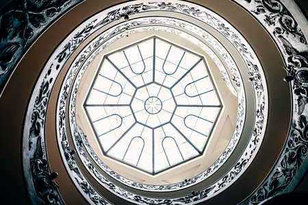 Spiral staircase with glass roof in Vatican Museum. Italy