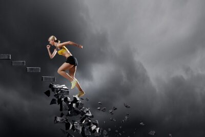 Canvas print Sports woman overcoming challenges