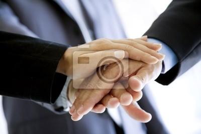 stacked hands, symbolising team-effort