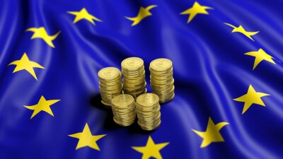 Canvas print Stacks of Euro golden coins on wavy flag of European Union