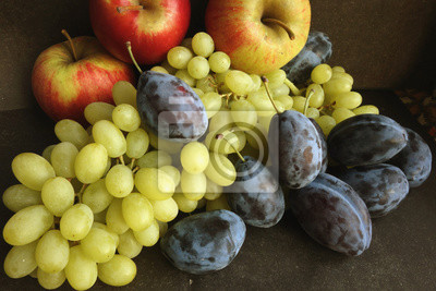 Still life of autumn fruits/  Red apples, yellow grapes and blue  plums - is not only beautiful, but also useful