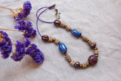 Still life with bohemian style necklace with flowers. Gypsy ethnic jewelry of polymer clay.
