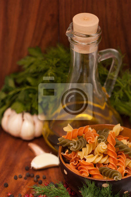 Still life with olive oil, Fusilli Pasta, herbs and spices