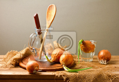 Still life with onions on wooden table