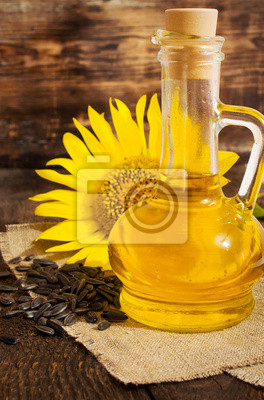 still life with vegetable oil in a glass bottle
