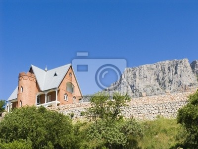 Stone cottage in mountains