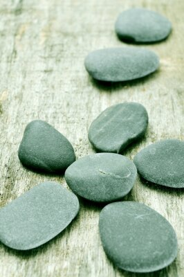 Canvas print stones on an old wooden surface