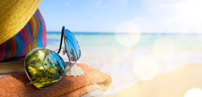Canvas print Straw hat, bag and sun glasses  on a tropical beach