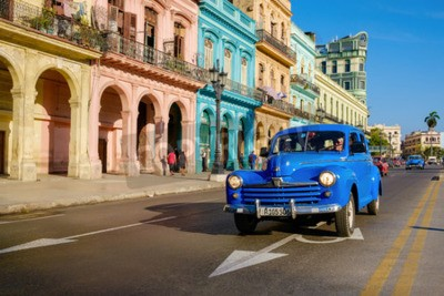 Canvas print Street scene with old car and colorful buildings in Old Havana