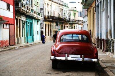 Canvas print Street scene with vintage car in Havana, Cuba