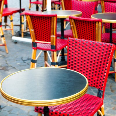 Canvas print Street view of a coffee terrace with tables and chairs