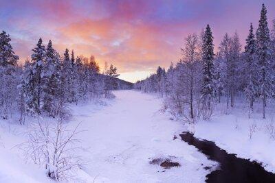 Canvas print Sunrise over a river in winter near Levi, Finnish Lapland