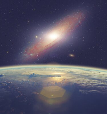 Canvas print Sunrise over Earth with great Andromeda galaxy.