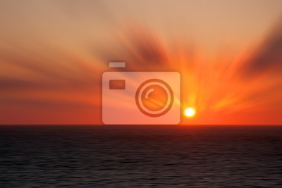 Sunset at sea with a photo effect