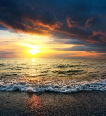 Sunset on sea with clouds